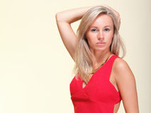 Lady in red woman dress yellow background Royalty Free Stock Image