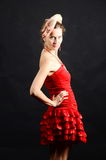 Lady in red dancing. A young lady in a red dress looking back Stock Images