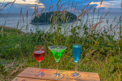 A lady relax on the hilltop with some drink drinks on hill top in front of wind turbine view point Stock Images