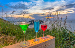 A lady relax on the hilltop with some drink drinks on hill top in front of wind turbine view point Royalty Free Stock Photography