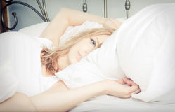 Lady relaxing in the bedroom Stock Photo