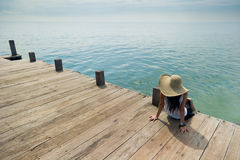 Lady relaxing at the dock. Photo of lady relaxing at the dock Royalty Free Stock Photography