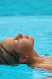 Lady relaxing in pool Royalty Free Stock Photography