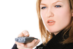 Lady with a remote control Stock Image