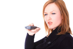Lady with a remote control Royalty Free Stock Image