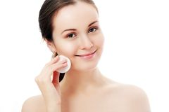 Lady removing makeup Stock Image