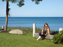 Lady resting near lake Huron Royalty Free Stock Images