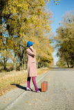 Lady in retro hat and overcoat with vintage Stock Images