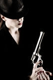 Lady with a revolver. Elegant lady in black holding a revolver Royalty Free Stock Image