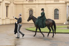 Lady rider and soldier at Osborne House. Osborne House is a former royal residence in East Cowes, Isle of Wight, United Kingdom. The house was built between royalty free stock image