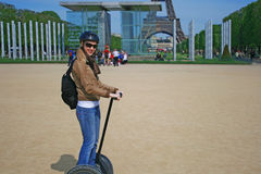 Lady Riding A Segway Machine In Paris Royalty Free Stock Image
