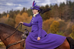 Lady in riding habbit. XIX Century at horse hunting Stock Photography