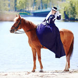The lady on riding walk. Stock Images