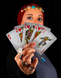 Lady of The Rings Holds All The Cards. Lady of the rings holds the game cards and looking mysteriously Royalty Free Stock Photography