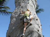 Lady rock climbing Stock Image