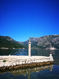 Lady on the rock island. In Montenegro Stock Photos