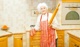 Lady with rolling pin Royalty Free Stock Image