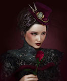 Lady Rose. A portrait of a lady with a rose Royalty Free Stock Image