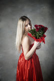 Lady with the rose. In an abandoned house Royalty Free Stock Photo