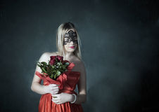 Lady with the rose. And mask in an abandoned house Royalty Free Stock Image