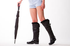 Lady in rubber boots with black umbrella. Royalty Free Stock Photography