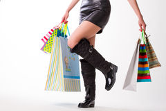 Lady in rubber boots and leather skirt. Stock Image