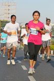 Lady running at Hyderabad 10K Run Event, India Stock Photos