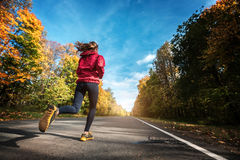 Lady runs on the road royalty free stock images