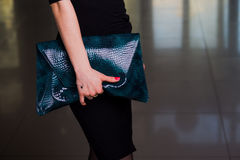 Lady's bag. Closeup of green leather handbag in hand of modern w Stock Images