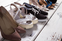 Lady's different shoes in row. Royalty Free Stock Photography