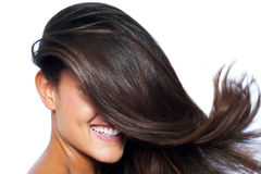 Lady's face covered with long straight hair Royalty Free Stock Images