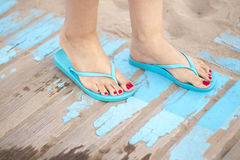 Lady& x27;s feet in sandals on beach stock image