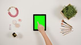 A Lady`s Finger Touching a Tablet royalty free stock photos