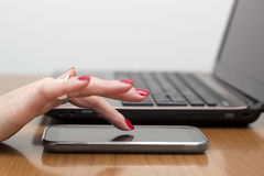 Lady's fingers touch the smart phone Royalty Free Stock Images