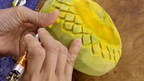 Lady`s hand crafting pumpkin in a floral pattern. Thai style royalty free stock photos
