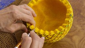 Lady`s hand crafting pumpkin in a floral pattern. Thai style stock photo