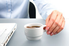 Lady's hand holding coffee cup. Stock Images
