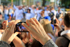 Ladys Hands Taking Photo of Olympics Event Royalty Free Stock Photos