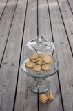Lady`s Kisses - Italian hazelnut sandwich cookies. On cake stand Royalty Free Stock Images