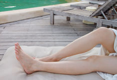 Lady's legs on a bed Stock Photos