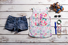 Lady's outfit with jeans shorts. Royalty Free Stock Photo