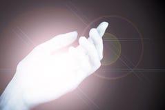Lady's palm emitting light Stock Image