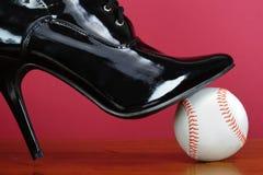 Lady's shoe on baseball Stock Images