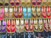 Lady`s shoes on shoe rack royalty free stock photography