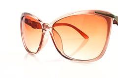 Lady's sunglasses close-up Stock Photos