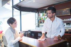 Lady sat at bar cafn�. Lady sat at bar of cafn Royalty Free Stock Image