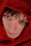 Woman in red headscarf. Portrait of sad looking woman gazing upwards and wearing red headscarf Stock Photos