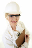 Lady science engineer. Attractive blond caucasian woman in white lab coat and white safety hard hat holding a chart or clipboard on white stock photos
