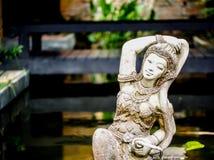 Lady sculpture in a Bali style garden Stock Photos