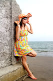 Lady by the sea. Young asian lady enjoying the beach view stock photos